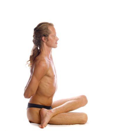 Man is making yoga isolated on white Stock Photo - 5854703