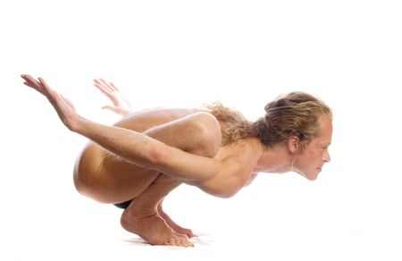 Man is making yoga isolated on white Stock Photo - 5965303