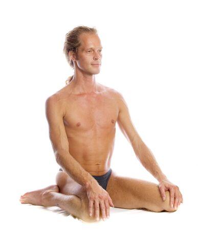 Man is making yoga isolated on white Stock Photo - 5965318