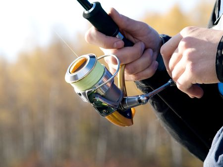 The fisherman with a fishing reel Stock Photo