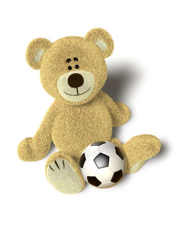 A cute teddy bear sits down on the floor and looks up into the camera. A soccer ball is in front of him between the legs. Isolated on withe background with soft shadows. photo