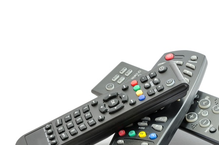 remote controls: Three TV Remote Controls isolated on white background Stock Photo