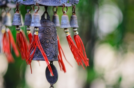 to chime: Feng Shui Chinese Bell and Coin being blown