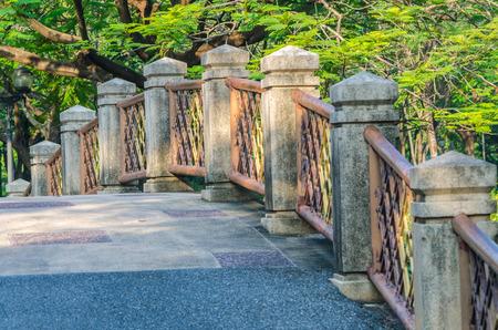 Walkway and Stone bridge railing in Chatuchak Park, Bangkok, Thailand photo