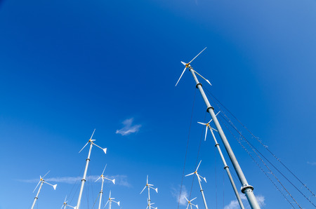 Wind turbines generating electricity with blue sky photo