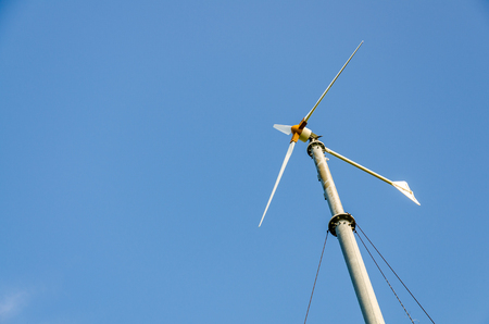 Wind turbines generating electricity with blue sky, Koh Larn, Pattaya, Chonburi, Thailand photo