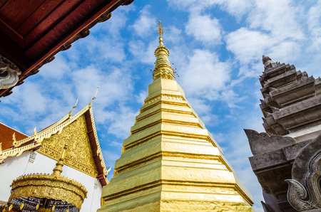 Golden Pagoda at Wat Phra That Cho Hae (the Royal Temple), Phrae Province, Thailand photo
