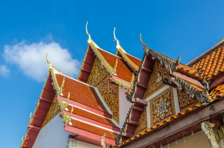 Gable roof on Thai temple in Wat Phra That Cho Hae (the Royal Temple), Phrae Province, Thailand photo