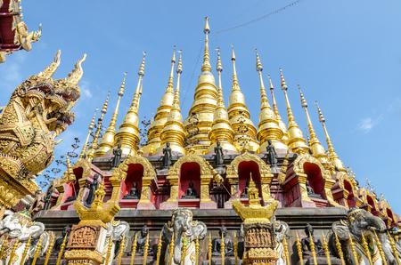 Golden pagoda at Wat Phra That Su Thon Mongkhon Khiri Samakkhi, Phrae Province, Thailand, Phrae Province, Thailand photo