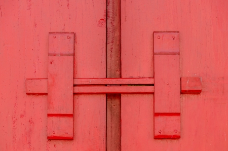Closeup lock of red wooden door in temple Thailand photo