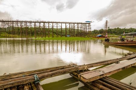 Old wooden Mon Bridge in Sangkhla Buri, Kanchanaburi Province , Thailand photo