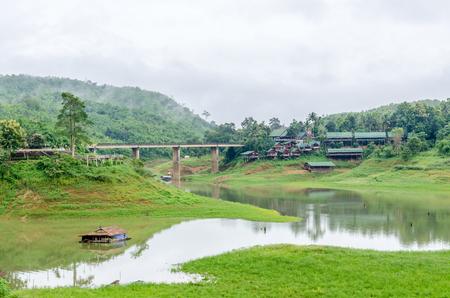 Rural life view of wooden Mon Bridge in Sangkhla Buri, Kanchanaburi Province , Thailand photo