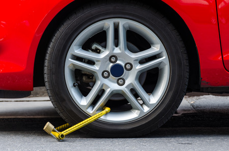 illegally: Clamped wheel of illegally parked car Stock Photo