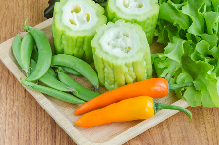 bitter orange: Mixed vegetable on wooden plate