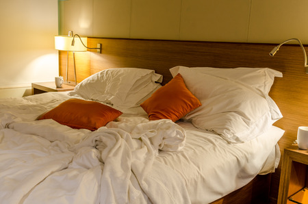 unmade: Unmade bed with white linens