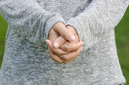 forgiven: Hands clasped together for a prayer