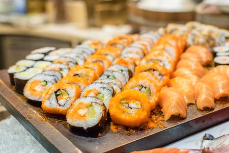 rearrange: Row of Traditional Japanese sushi rolls