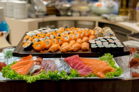 rearrange: Row of Traditional Japanese sushi and sasimi