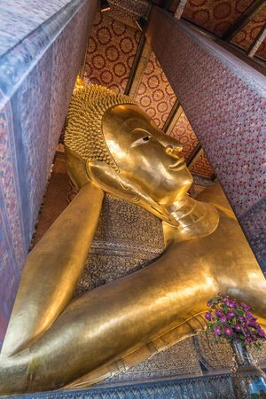 reclining: Reclining Buddha at Wat Pho in Bangkok, Thailand