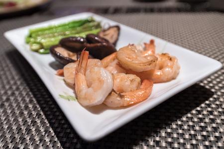 cook griddle: Prawns teppanyaki with asparagus and mushroom Stock Photo