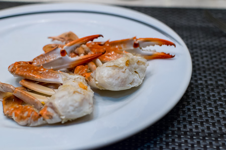 two piece: Two piece of crab on white dish