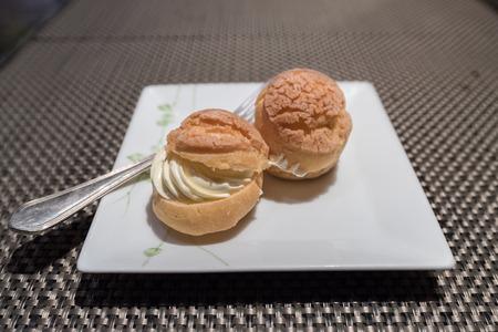 creampuff: Sweet Eclair, Cream Puff, or Choux Stock Photo