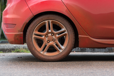 Dirty wheel of red car Stock Photo