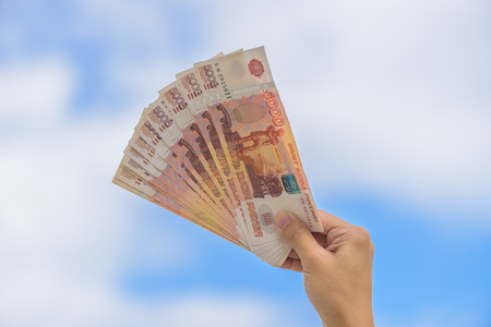 show bill: Female hand show Russia Ruble money with beautiful background