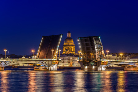Open Blagoveshchensky Bridge with Saint Isaacs Cathedral in Saint Petersburg, Russia