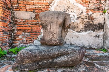 Headless Ancient Buddha statue at Wat Mahathat  (Temple of the Great Relic) in Ayutthaya, Thailand