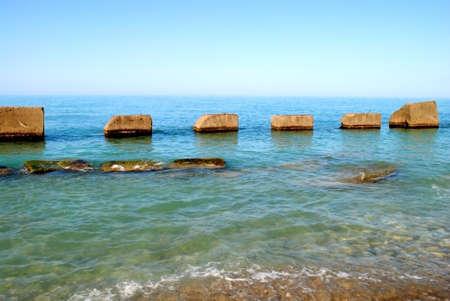 concrete breakwaters on the seashore