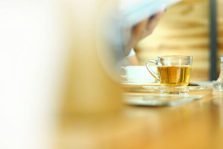 Hot tea on the table, selective focus and free space for text. 免版税图像