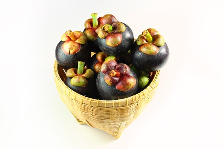Still life photography of Thai fruit: Mangosteen is queen of fruits. Organic mangosteen is popular fruits in basket on the sack floor. Shooting in studio, Clean food and tropical fruits concept.
