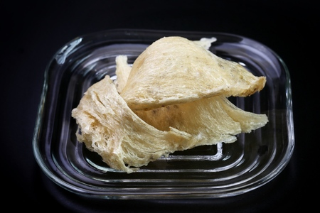 The nest of Edible-Nest Swiftlet, raw edible bird's nest materials for tradition chinese medicine. Edible nest soup is popular at Hong Kong, Taiwan, China and Southeast Asia. Selective focus. Stock Photo