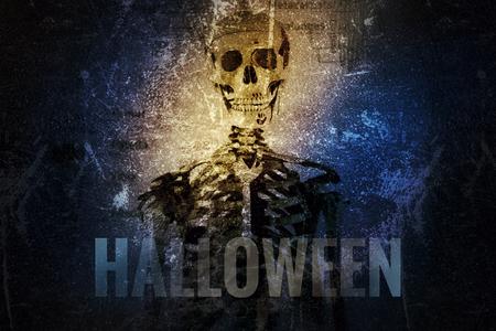 Multiple exposure, skull and  skeleton for Halloween background. Stock Photo