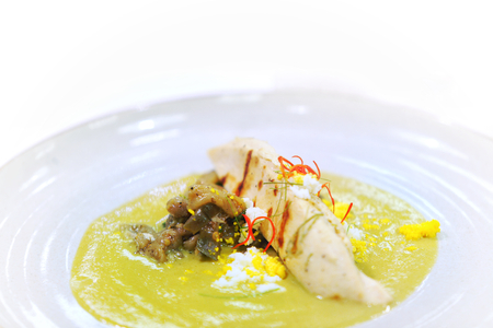Still life photography of Thai green curry with chicken served with spicy curry Thai style sauce. Selective focus.