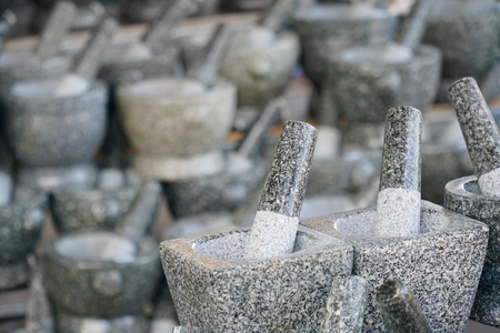 Stone mortar in the mortar store. Stone mortar is kitchenware for preparation for cooking food.