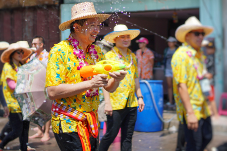CHONBURI, THAILAND-APRIL 13,2019 : Beautiful parade Songkran Festival at Thailand. Foreign tourists and Thai people enjoy splashing water together with celebration parade. Selective focus.