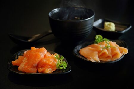 Japanese food: Mix sashimi and served with Japanese cooked rice on table. Clean food concept. Toned image. Selective focus and free space for text. Stock Photo - 129138971