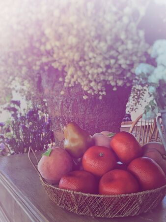Fake fruits decorate on the table. Vintage effect image. Free space for text.
