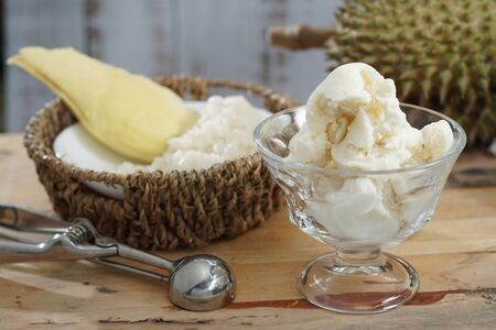 Still life photography of Durian ice cream on the table, shooting in studio. Popular fruit for dessert in Asian served with durian and sticky rice, Tropical dessert fruit concept for advertising.