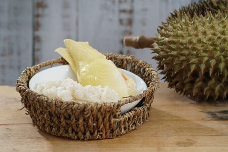 Still life photography of Durian the king of tropical fruits on white background with path, shooting in studio. Popular dessert in Thailand served with sticky rice and fresh coconut milk on topping. Stockfoto