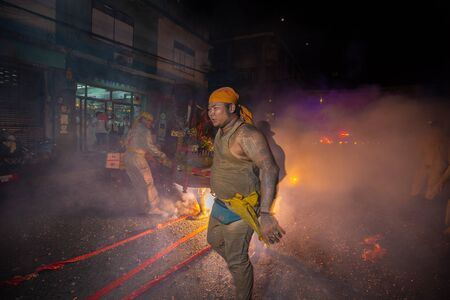 CHONBURI, THAILAND - SEPTEMBER 30, 2019: At night, The parade possessed by his god walking on fire in Vegetarian Festival also known as Nine Emperor Gods Festival. Stop action and motion blur. Redakční