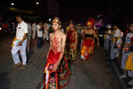 CHONBURI, THAILAND - SEPTEMBER 30, 2019: At night, The parade possessed by his god walking in Vegetarian Festival also known as Nine Emperor Gods Festival. Stop action and motion blur.