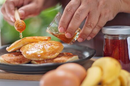 Pancakes served honey on table, healthy breakfast for everyday. Clean food good taste for advertising ideas concept.