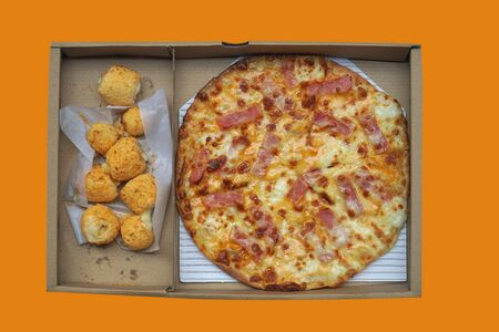 Pizza and cheese balls in paper box isolated on orange background. This image stacked with clipping path for advertising. ideas concept.