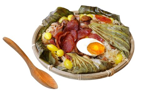 Steamed Fried Rice in Lotus Leaf, popular food, Steamed rice stired with dry shrimps, chinese sausages, chestnut, ginkgoes and salted egg. Isolated on white background with clipping path. Фото со стока