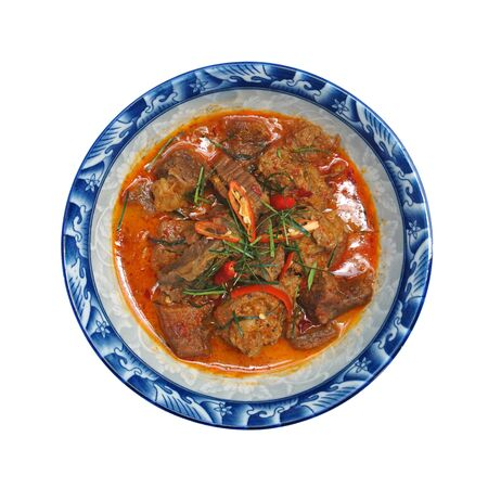 BEEF PANANG CURRY isolated on white background, image with clipping path. Popular Thai food. Beef curry with coconut milk, chili, and spicy herbs. Served with steam jasmine rice. Shoot in studio, Clean food good taste idea concept. Фото со стока