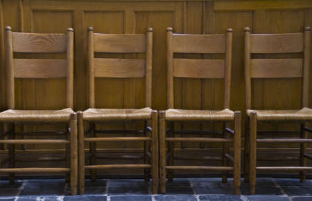 Four chairs in line at church