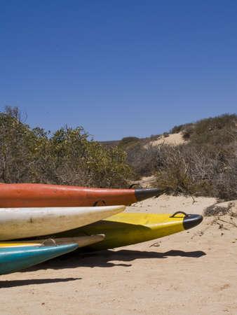 Canoe tips in dunes.